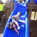 kid on a slide