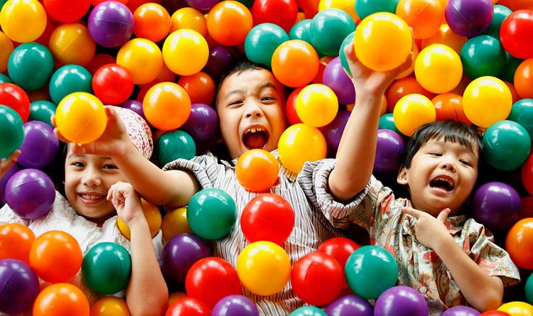 Kids playing with colorful balls